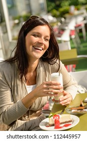 Woman at cafe bar holding latte drink smiling happy coffee