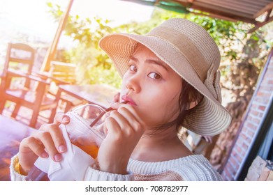 woman in a cafe drinking coffee.