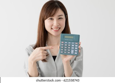 A woman with a calculator