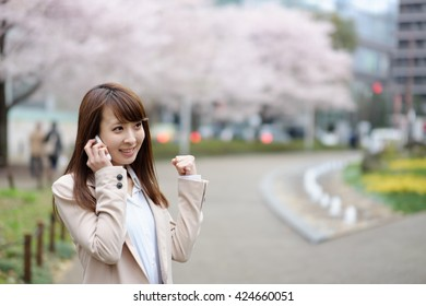 woman to call in the background of cherry tree