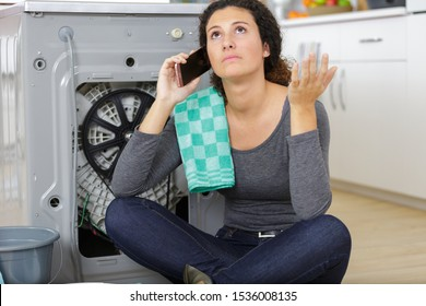 woman calling for appliance repair service