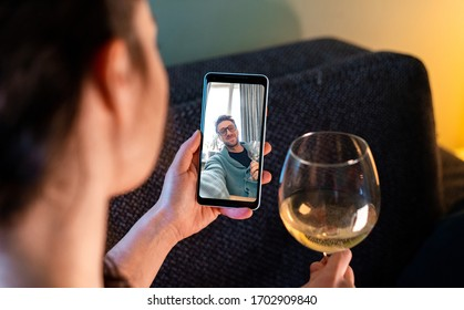 Woman Calling By Video Chat Her Friend And Drinking Wine With Him. Online Date, Meeting With Friend. Stay Home. Social Distance and Isolation