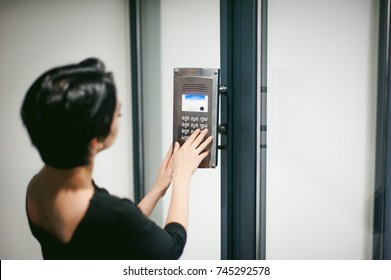 woman is calling on the intercom