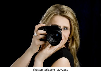 Woman with camera aiming at you
