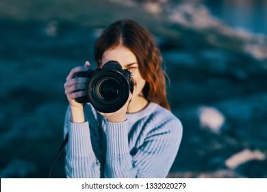 Woman camera blue sweater nature lens