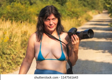 Woman with camera on a hot summer day