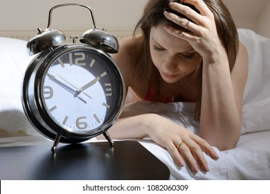 Woman can not fall asleep late at night and is sleepless because of worries, anxieties and depression