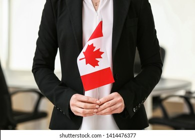 Woman with Canadian flag indoors