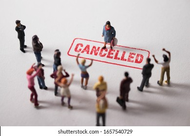 Woman with cancelled stamp in front of angry mob. Person is the latest victim of toxic cancel culture. Girl is bullied or excluded by friends, family, social media followers. Offensive woman labelled.