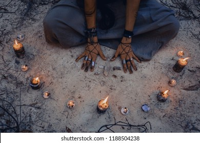 woman with candle deep in forest. Witch craft concept