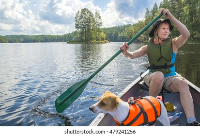 Woman canoeing on lake in Finland