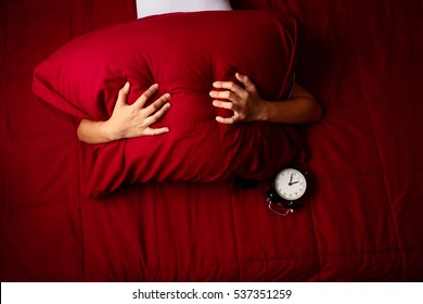 woman can't fall asleep because of the noisy