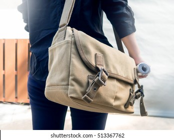 Woman with canvas shoulder bag.Concept of messenger,student,traveler