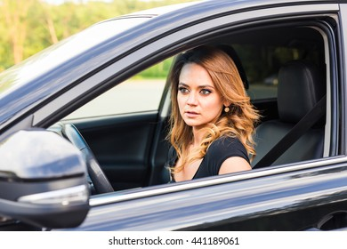 Woman in car.