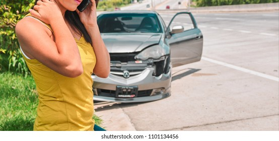 Woman in car accident calling for help on road side assistance