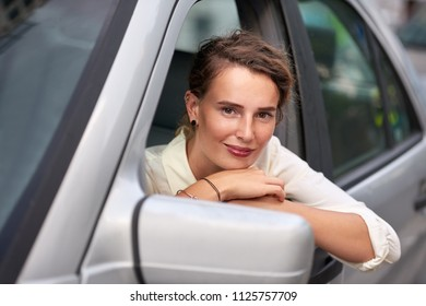 Woman with car in city portrait