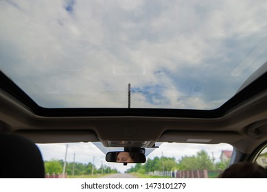 woman car driver eyes reflection in mirror. sunroof copy space