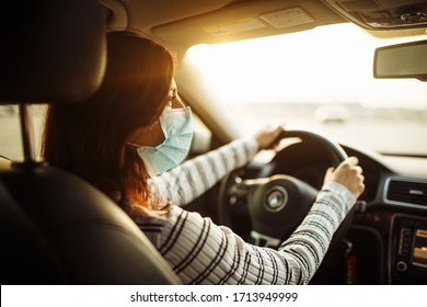 Woman car driver rides wearing medical sterile mask during pandemic coronavirus quarantine. Transport isolation to stop spread of virus of covid-19. Healthcare concept