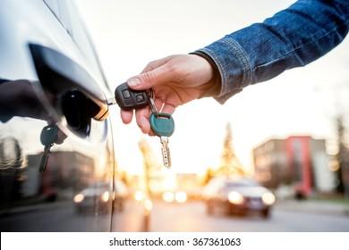 Woman with car key - Shutterstock ID 367361063