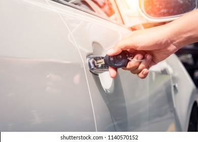 Woman with car key left in a lock,copy space,filter color effect.