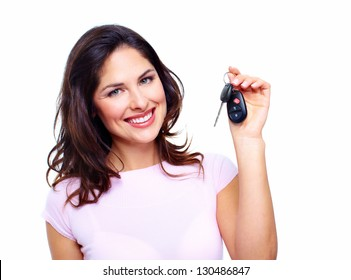 Woman with a car keys. Isolated on white background.