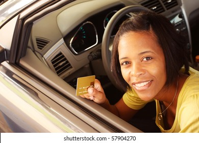 Woman in car paying with credit card