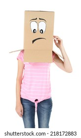 Woman with cardboard box on her head with sad face, isolated on white