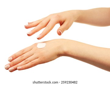 Woman caring hands with cream isolated on white