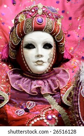 Woman with a carnival mask which looks like a doll (Annecy/France)