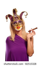 Woman in carnival venetian mask posing with cigar isolated on white