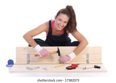 woman carpenter at work on white background