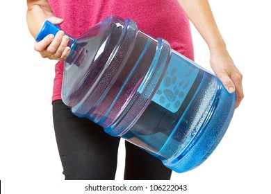 A woman carries a heavy large bottle (20 liters) of drinking water. Isolated on white background
