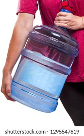 Woman carries a large bottle drinking water 20 liters