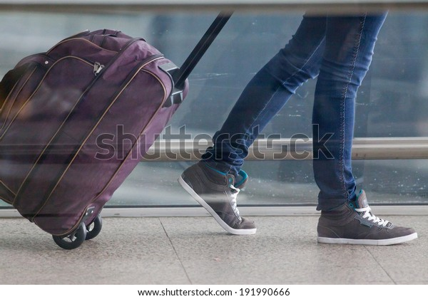 Woman carries your luggage at the airport terminal of Hong Kong