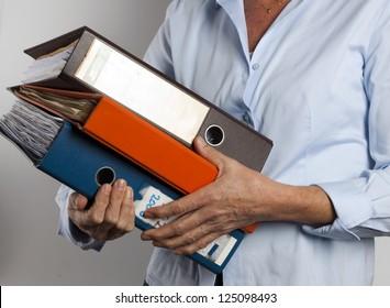 woman carrying binders