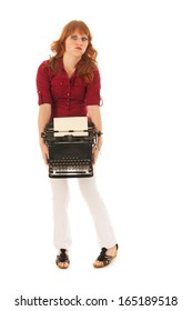 Woman is carrying a heavy vintage black typewriter