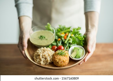 Woman carrying organic vegetable dish