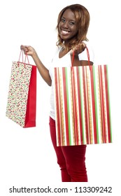 Woman carrying shopping bags. She grabbed great discounts from sale on purchases
