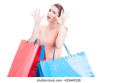 Woman carrying shopping feeling scared or afraid making stop gesture with both hands isolated on white with copy text space
