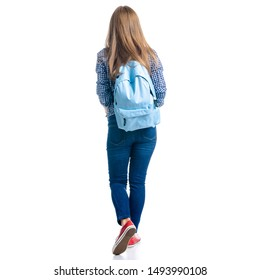 Woman in casual clothing student with backpack looking goes walking on white background isolation, back view