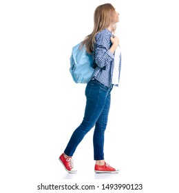 Woman in casual clothing student with backpack looking smiling goes walking on white background isolation