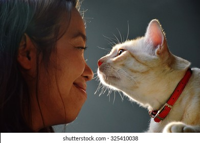 woman and cat eye contract together