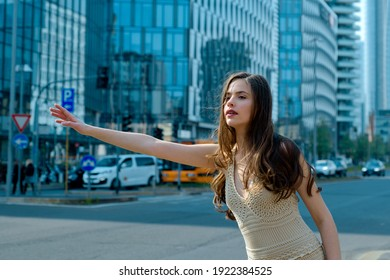 Woman catch taxicar. Hailing a taxi. Transport car. Get a ride