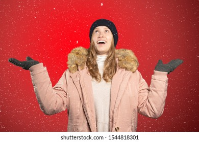 a woman catches snowflakes with her mouth and tongue
