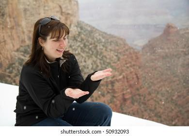 Woman Catching Falling Snow
