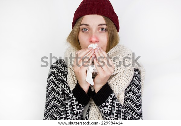 Woman Caught Cold. Sneezing into Tissue.