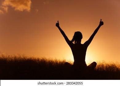 Woman celebrating in a beautiful setting.