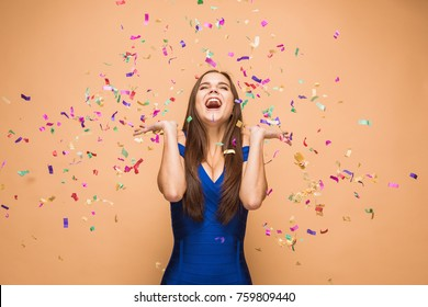 The woman celebrating birthday on brown background