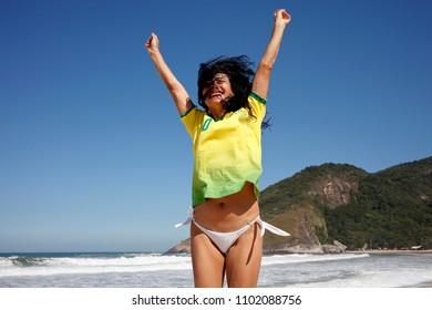 Woman celebrating goal in soccer Brazil