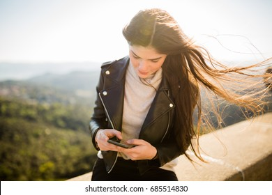 Woman with cell phone outdoors